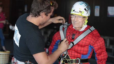 .John Morley, 91, gets ready for the abseil at Ipswich Hospital. Picture: NIGE BROWN