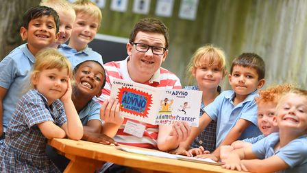 Sixth-former Adam Cullen read to the reception class at St Matthews Primary School. Picture: GREGG B