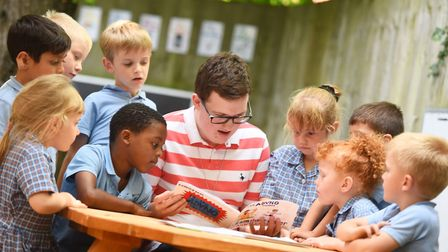 Children listen attentively to Adam Cullen reading his story. Picture: GREGG BROWN