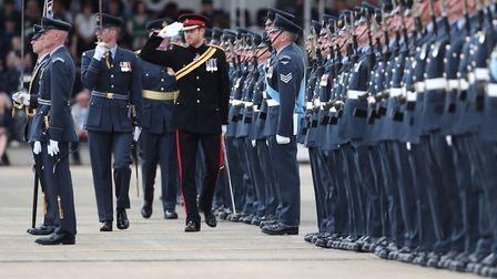 Prince Harry inspects the honour guard as he arrives at RAF Honington in Suffolk. Picture: GARETH FU