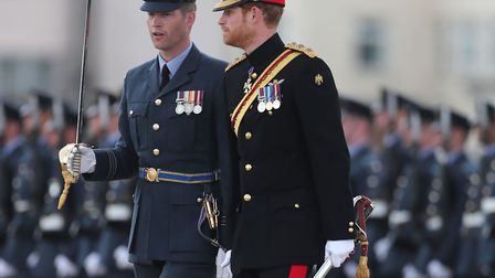 Prince Harry inspects the honour guard as he arrives at RAF Honington. Picture: GARETH FULLER/PA WIR