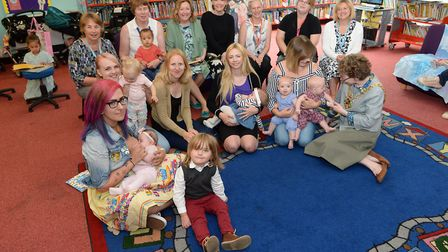 Ipswich mayor Sarah Barbe with mothers with their children in Ipswich Library, with professionals sa