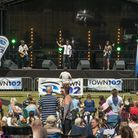 Music day goers watch a band on the Town 102 stage. Picture: ASHLEY PICKERING