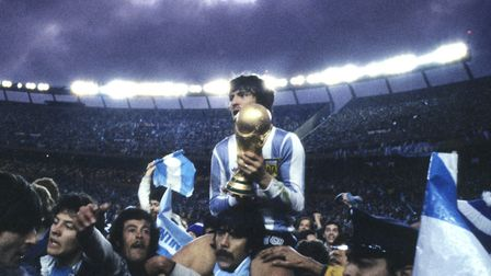 Tarnished glory? Argentina captain Daniel Passarella holds the trophy after the 1978 World Cup Final
