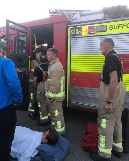 Firefighters helping at the incident. Picture: PETER TAMPION