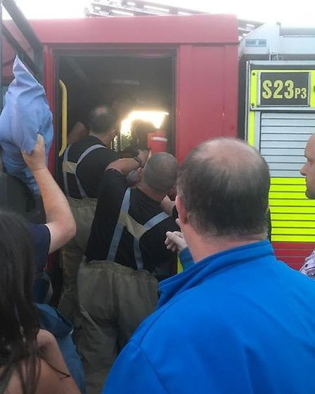 Suffolk Fire and Rescue Service helping 16-year-old Henry Wilkins after he was injured during a foot
