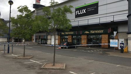 �The police cordon outside several restaurants in Cardinal Park, Ipswich. Picture: JASON NOBLE�