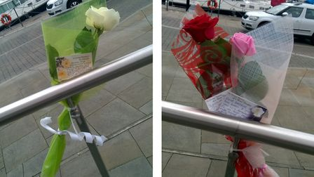 The flowers and cards left at Ipswich waterfront on Wednesday. A few hours later they had been stole