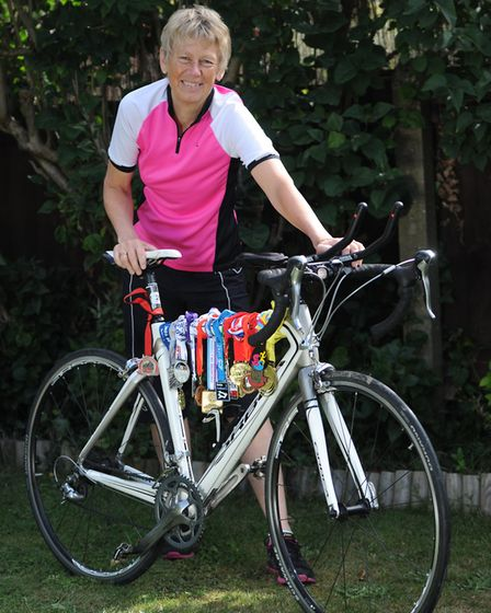 Heather Guttery with her bike and medals. Picture: SARAH LUC Picture: SARAH LUCY BROWN