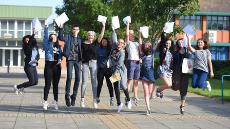 GCSE results day at Northgate High School. Students jump for joy. Picture: GREGG BROWN