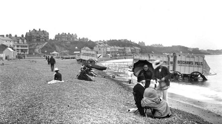 Victorians on the beach in 1889. The bathing huts were so that swimmers could enter the water unseen