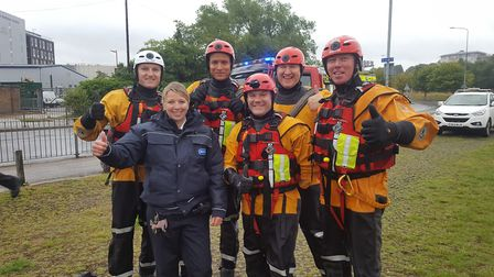 Rescuers from the Suffolk Fire and Rescue Service celebrate the successful rescue operation of a bab