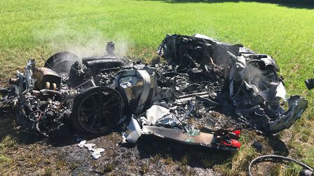 The remains of the Ferrari 430 Scuderia in a field after it crashed off the M1 motorway in South Yor
