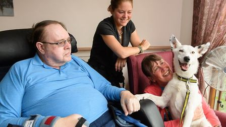 Lily with owner, Anne Goad, her cousin and resident at Baylham Care Centre, Brian Mellowship, and (c