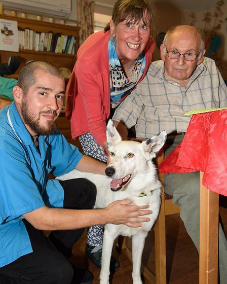 Lily with senior care worker Francisc Imre, owner Anne Goad and resident Derek Jaggard at Baylham Ca