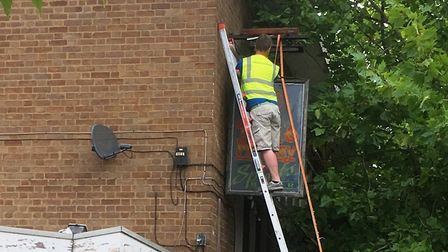 The sign comes down at the Drum and Monkey. Picture: PAUL GEATER