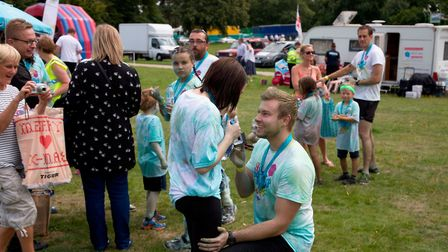 """The """"breathtaking moment"""" Daniel West proposed to girlfriend Becky Burch at the finish line of Ipswi"""