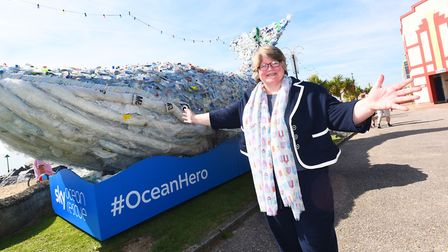 Suffolk Coastal MP Therese Coffey with Sky Ocean Rescue's 10 metre plastic whale. Picture: GREGG BRO