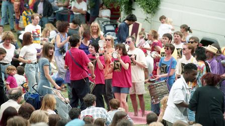 A percussion band moves through the crowds