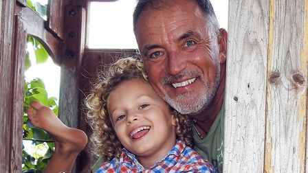 Paul Nixon with grandson Marley. Picture: PAUL NIXON PHOTOGRAPHY