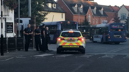 Police in Dogs Head Street, Ipswich, where a man was reported as being aggressive. Picture: MEGAN AL