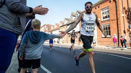 There was good support along the route - with this young spectator high-fiving one of the competitor