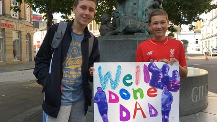 Josh and Oliver Holland, 15 and 11, from Stowmarket, were cheering on their dad Tony. Picture: ADAM