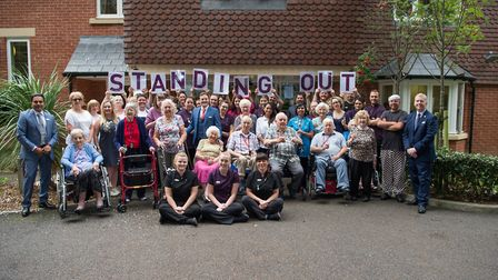 Staff and residents celebrate the Ipswich care home's 'outstanding' rating. Picture: CONTRIBUTED