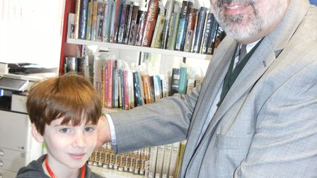 James receives his Summer Reading Challenge medal from Kesgrave Town Council chairman Neal Beecroft-