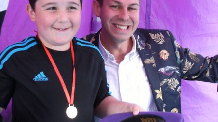 Kyle (left) with magician Mr Bean at the Kesgrave Library Summer Reading Challenge presentation