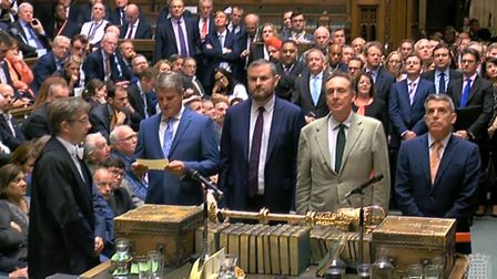 MPs line up to read out the vote in the House of Commons Photo: PA