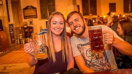 Customers at the Saints Oktoberfest in Ipswich enjoying German beer in traditional steins. Picture: