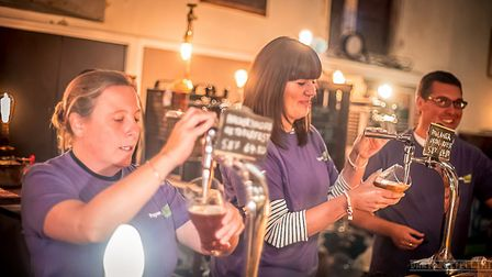 Volunteers from LV= were pouring the pints to raise cash for the Papworth Trust. Picture: DARIO VITE