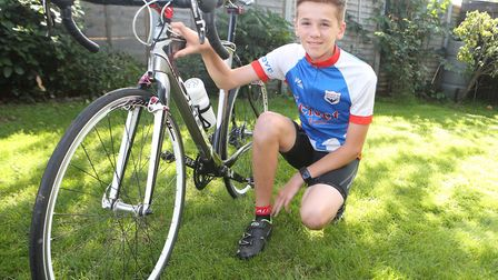 Charlie Johnson, 13, from Ipswich, is cycing 300 miles for charity. Picture: SEANA HUGHES