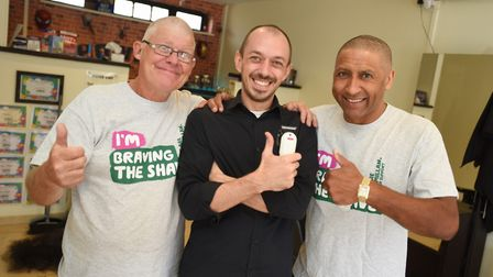 Brave the shave at Howies Barber Shop. Left to right, Mike Cartwright, hairdresser James Howard and