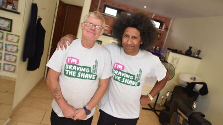 Brave the shave at Howies Barber Shop. Going under the scissors is Chris Ward and Mike Cartwright. P