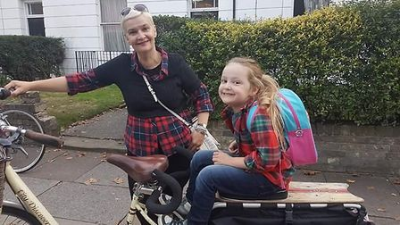 Anna Matthews and her daughter Agnes with the bike, which has been stolen. Picture: ANNA MATTHEWS
