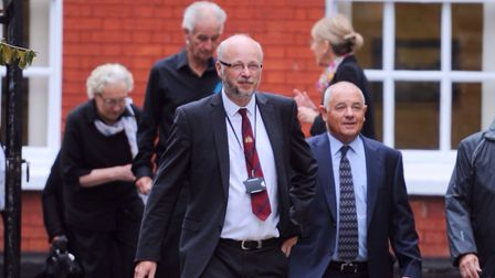 Current chief executive Russell Williams and former council manager Rodney Cook arrive at St Mary Le