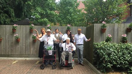 Jack Stockings and Peter Pearson (front) with staff from Bucklesham Grange Care Home Ipswich at the