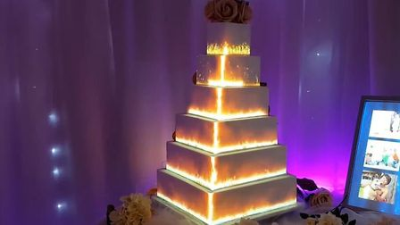 A cake displaying projections interacting with each level. Picture: ANGIE SCOTT CAKES