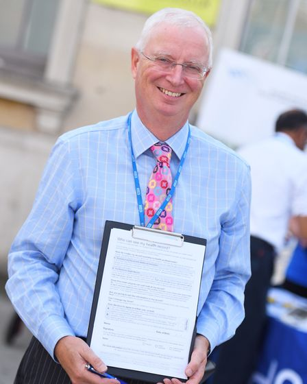 Dr John Hague with the health record sharing consent form. Picture: GREGG BROWN