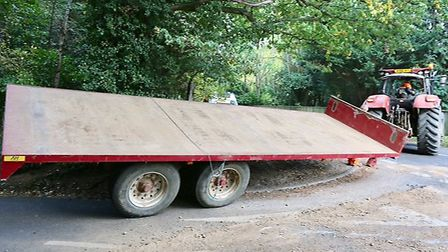 The trailer which spilled potatoes on the road. Picture: GARY DONNISON