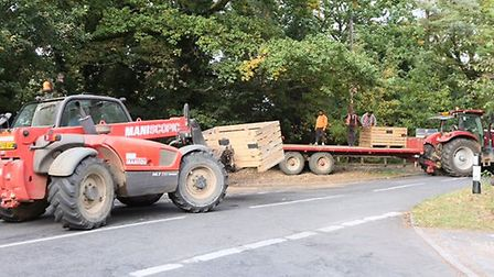 A tractor's trailer overturned today near Little Bealings. Picture: GARY DONNISON