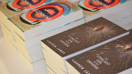 Copies of author Lauren James' books were available to have signed at Ipswich high School. Picture: