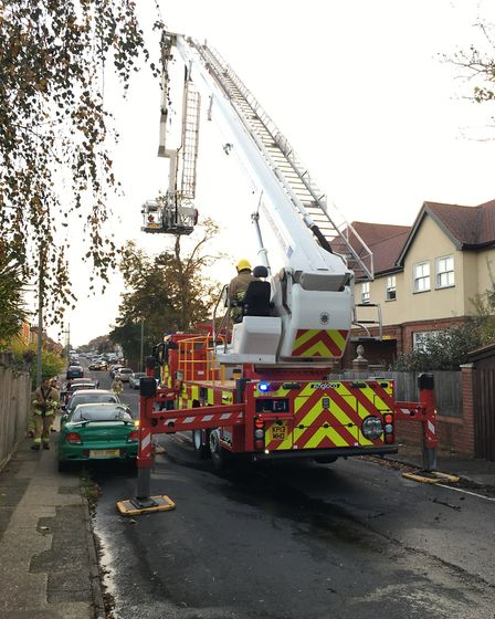 After putting out the fire, crews used the aerial appliance to check for hotspots on the roof of the