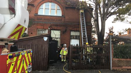 The fire is believed to have started in a bin at the side of the building and then spread to a woode