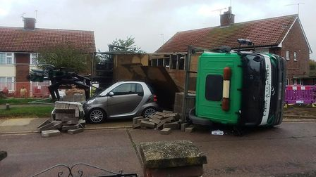 Police were called after a lorry toppled over and damaged a Smart car in Sheldrake Drive, Ipswich. P