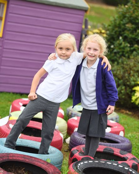 Ella (left) and Ellice playing in the new Year 1 play area at Dale Hall Community Primary School. Pi