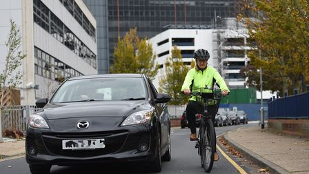 Police are cracking down on motorists who drive too close to cyclists. (Picture has been staged for