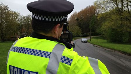 Policeman with a speed gun. Stock picture: Archant.